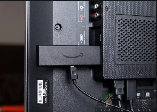 Inserting the Amazon Fire TV Stick into the TV
